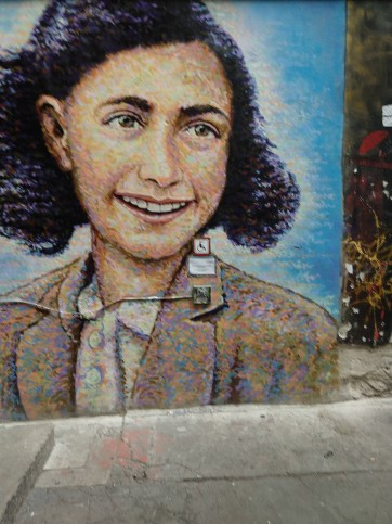 A portrait of Anne Frank on one of the walls