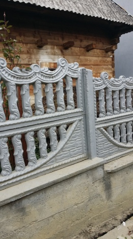 This fence was made from cement in a form.