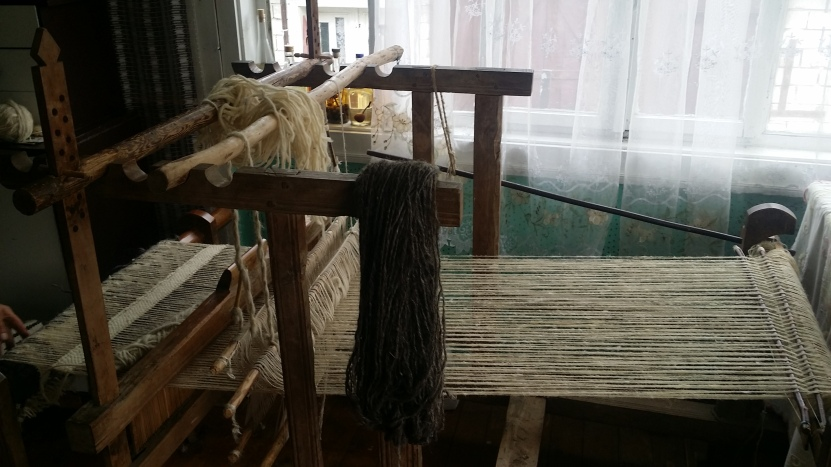 A loom was in the museum for people to see how the hand crafts were made.