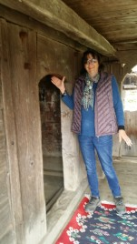 Rebecca shows the size of the doors in the old wooden church.