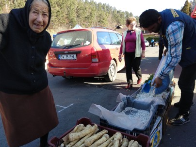 On market day near Bran, the old meet the new.