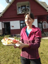 Ioana offers homemade cheeses, pepers, and dried meats.