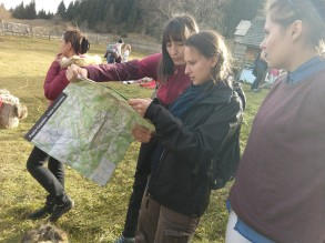 Ioana shows Emmy the routes on the Mountain Ecology Center map.