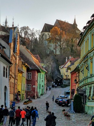 Downtown Sighisoara, just at dusk, taken from our outdoor dining table in the square.