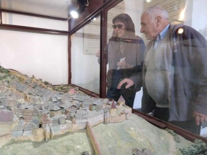 Ioan points out their house on a model of the Citadel, which was located on the second floor of the clock tower.
