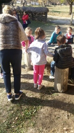 Teacher guides students in outdoor activity.